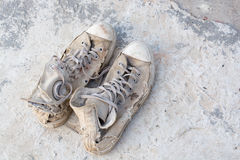 Old shoes left on the floor of the house screaming cracking. Stock Photos