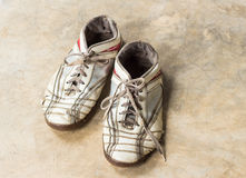 Old shoes on marble floor Stock Photo