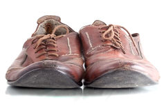 Old shoes. This is old shoes. One of a pair of outer coverings for your feet, usually made of leather or plastic.Humen use it for a long time stock photos