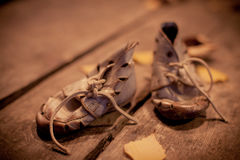 Old shoes for poor child Royalty Free Stock Photos