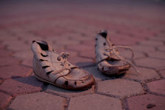 Old shoes for poor child Royalty Free Stock Photo