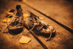 Old shoes for poor child Royalty Free Stock Images