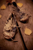 Old shoes for poor child Royalty Free Stock Image