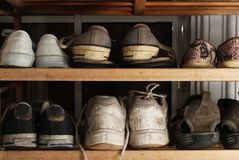 Old shoes on rack Royalty Free Stock Photos