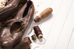 Old shoes and recovery tools. Background stock photography