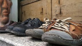 Old shoes  stop walking on weekend Royalty Free Stock Images