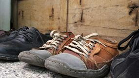 Old shoes  stop walking on weekend Royalty Free Stock Photos