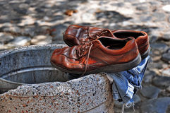 Old shoes in the trash Royalty Free Stock Image