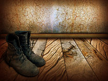 Old shoes on wood background Stock Photography