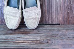 Old shoes. On wood background Stock Photography