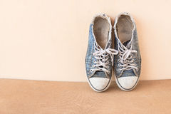 Old shoes on wood background Royalty Free Stock Photos
