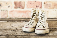 Old shoes on wooden background Royalty Free Stock Image