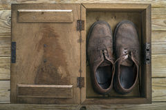 Old Shoes in Wooden Box Royalty Free Stock Photo