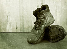 Old shoes on a wooden floor. Stock Photography