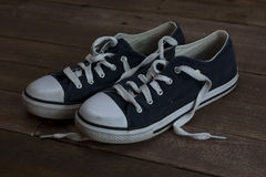 Old shoes on a wooden floor Stock Photography