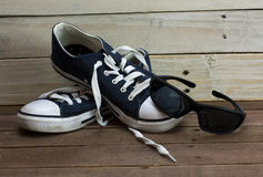 Old shoes on a wooden floor Stock Photo