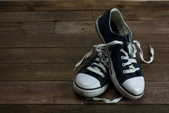 Old shoes on a wooden floor Royalty Free Stock Photography