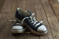 Old shoes on a wooden floor Stock Images