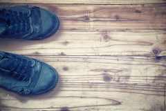 Old shoes on wooden plank background.vintage tone. Stock Photography