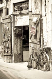 Old shop and bicycle Stock Images