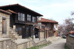 Old shop houses. It is the main trade street of Bulgarian village of Zheravna. The street is paved with stones. It looks like as in the old centuries. The old Royalty Free Stock Image