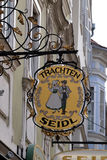 Old shop sign for Trachten Seidl made of wrought iron, hanging outside shop in Graz Royalty Free Stock Photography