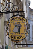 Old shop sign for Trachten Seidl made of wrought iron, hanging outside shop in Graz Stock Image