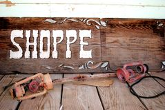 Old Shoppe Sign. An old western Shoppe Sign Stock Photos