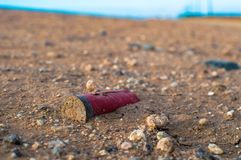 An old shotgun shell in the Arizona desert Stock Photos