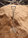 Old shovel dig in sand Royalty Free Stock Photography