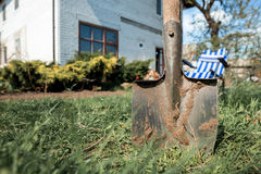 An old shovel on the grass Royalty Free Stock Photography