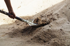 Old shovel in sand for construction Royalty Free Stock Images