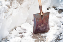 Old shovel in the snow Stock Photo