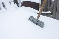 An old shovel in the snow. Snow cleaning. Background Stock Image