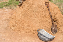 Old shovels and buckets. Old shovels and buckets beside a pile of dirt in the garden Royalty Free Stock Image