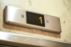 Old shower in a hotel detail. Digital lift number display 1 Royalty Free Stock Image