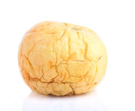 Old and shrivelled apple Royalty Free Stock Image