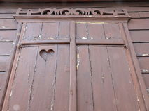 Old shutter with cut heart Stock Image