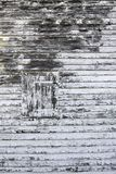 Old wooden shutter with peeling paint stock images
