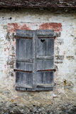 Old shutter window on stone wall Royalty Free Stock Photography