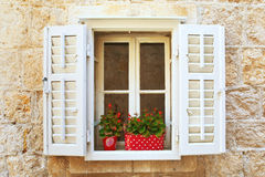 Old Shutter windows with a flowers. Croatia. Royalty Free Stock Photo