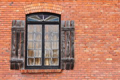 Old Shuttered Window on Brick Royalty Free Stock Images