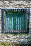 Old shuttered window. With metal bars Stock Photo