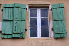 Old shuttered windows and old stonework, France stock photos