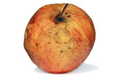 Old, sick apple, bad skin on white. Stock Photography
