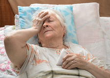 Old sick woman Stock Photography