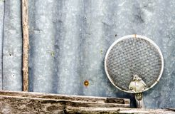 Old sieve keep on the old zinc wall in my home Stock Photos