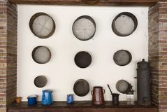 Old sieves on the wall Stock Images