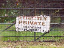 Old sign on gate strictly private trespassers will be prosecuted. Essex; england; uk Royalty Free Stock Photography