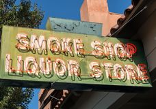 Smoke shop and liquor store sign Stock Images